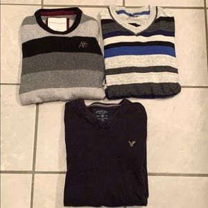 Lot of three sweaters.